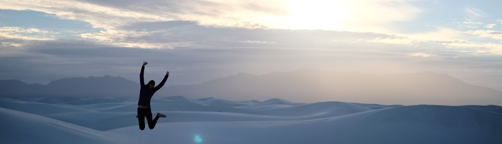 Jumping at sunset in White Sands National Park